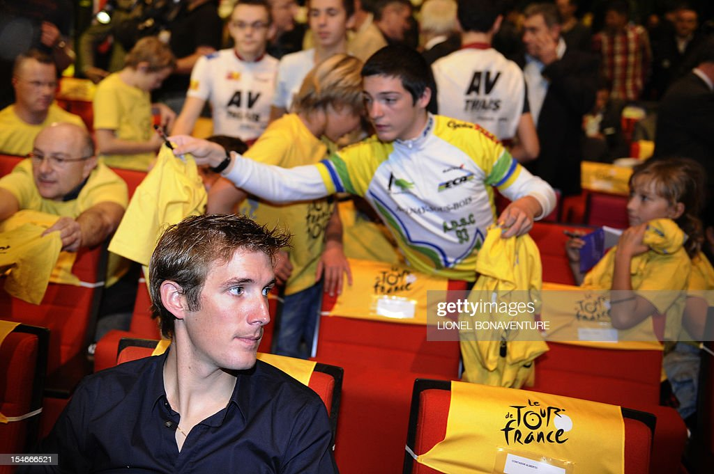 Luxembourg's cyclist Andy Schleck sits prior to the unveiling of the 2013 cycling classic Tour de France route on October 24, 2012 in Paris. The 100th edition of the Tour will take place from June 29 to July 21 and will start in Corsica for the first time in its history. AFP PHOTO LIONEL BONAVENTURE