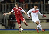 Luxembourg's defender Chris Philipps vies Turkey's Mevlut Erdinc during the friendly football match between Luxembourg and Turkey at the Josy Barthel...