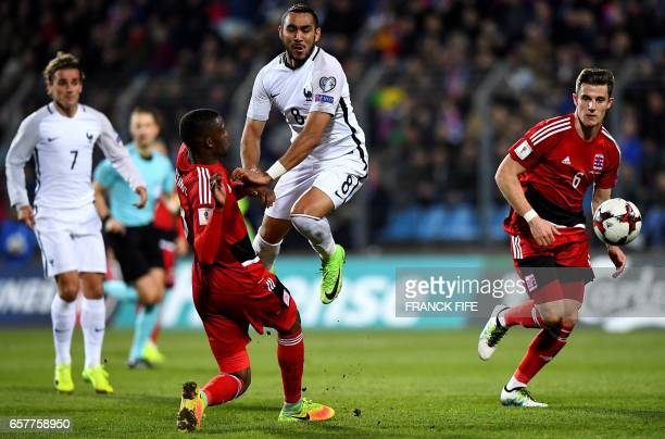 Luxembourg's defender Christopher Martins Pereira vies with France's forward Dimitri Payet during the FIFA World Cup 2018 qualifying football match...