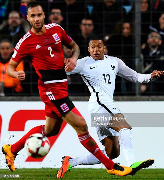 Luxembourg's defender Maxime Chanot vies with France's forward Kylian Mbappe during the FIFA World Cup 2018 qualifying football match Luxembourg vs...