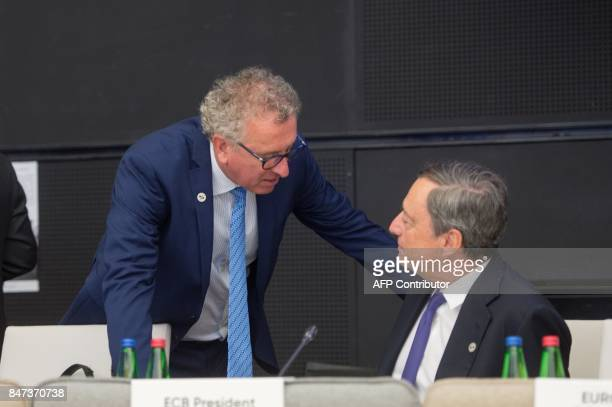 Luxembourg's Finance Minister Pierre Gramegna and President of the European Central Bank Mario Draghi chat during an informal meeting of the Eurozone...