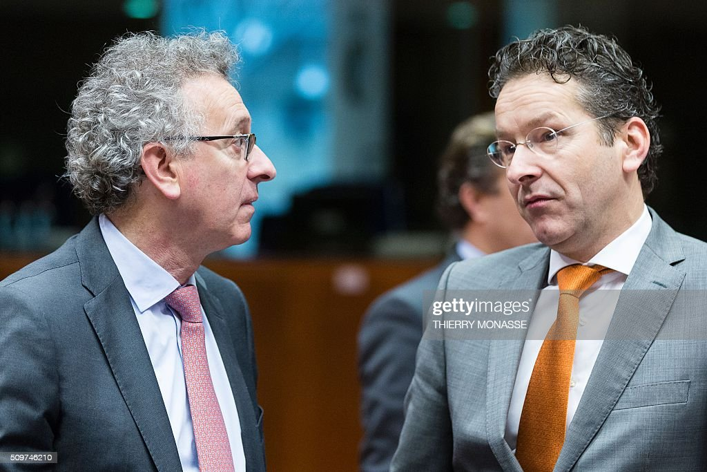 Luxembourg's Finance minister, Pierre Gramegna (L) talks with Eurogroup chief Jeroen Dijsselbloem prior to the European Union Eco-Finance Council meeting at the EU Council building in Brussels on February 12, 2016. AFP PHOTO / THIERRY MONASSE / AFP / THIERRY MONASSE