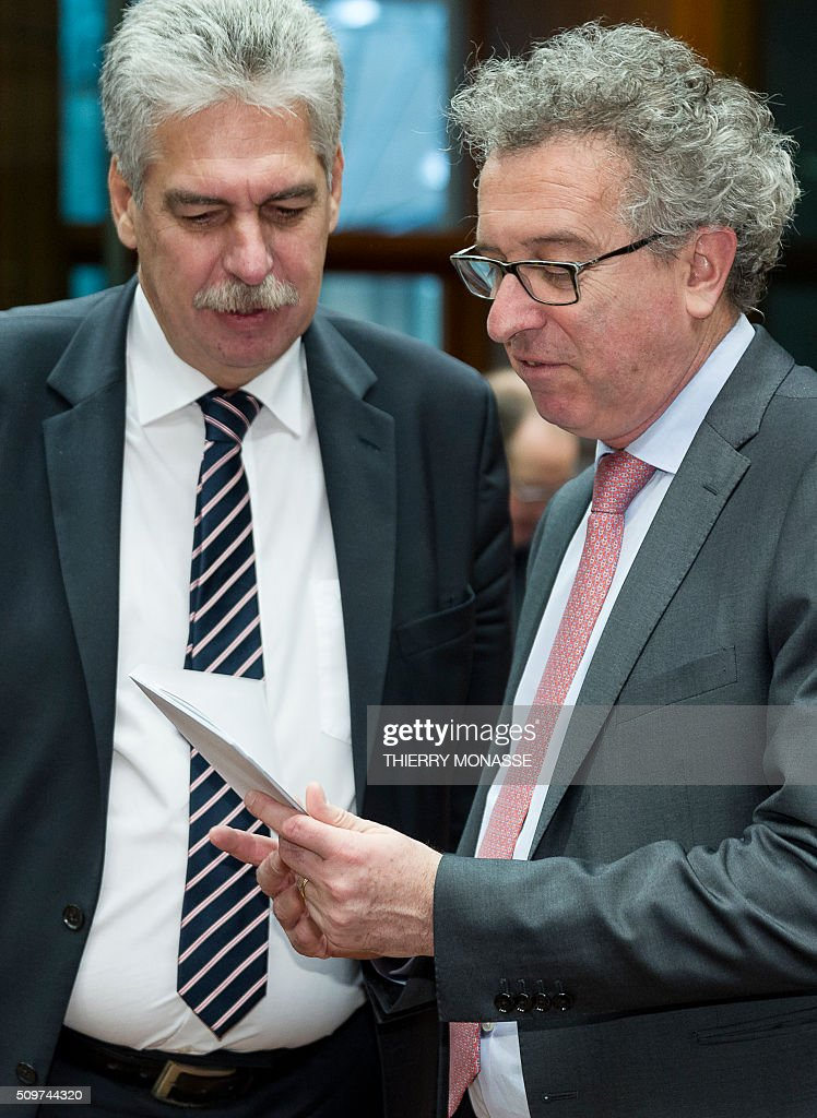 Luxembourg's Finance minister, Pierre Gramegna (R) talks with his Austrian counterpart Hans Jorg Schelling prior to the start of the European Union Eco-Finance Council meeting at the EU Council building in Brussels on February 12, 2016. AFP PHOTO / THIERRY MONASSE / AFP / THIERRY MONASSE