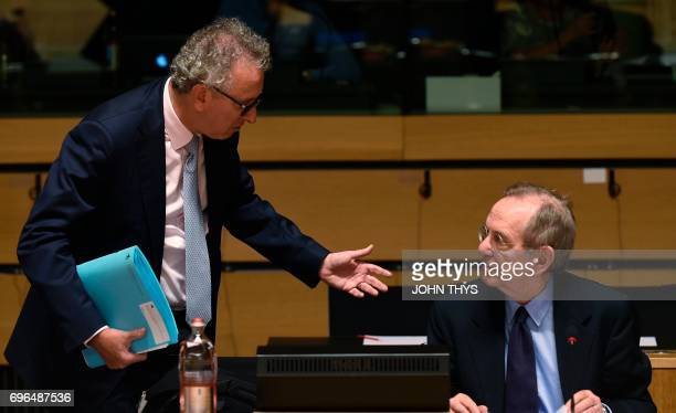 Luxembourg's Finance Minister Pierre Gramegna talks with Italian Minister of Economy and Finance Pier Carlo Padoan during an Ecofin meeting in...