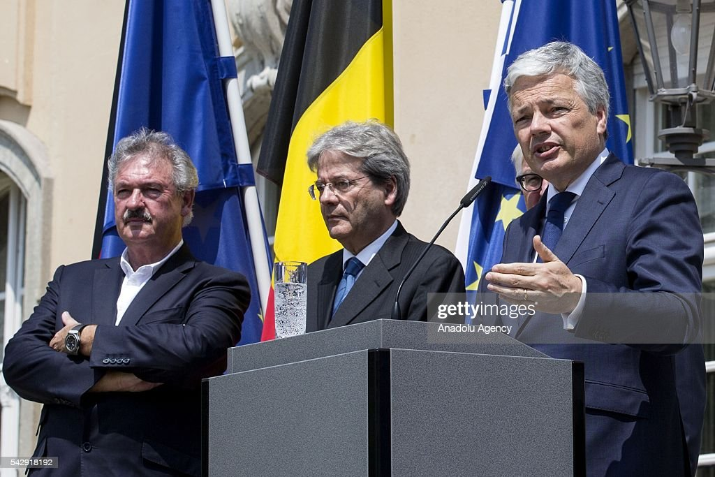 Luxembourgs Foreign Minister Jean Asselborn (L), Italian Foreign Minister Paolo Gentiloni (2nd L) and Belgian Foreign Minister Didier Reynders (R) attend a press conference after their meeting to discuss United Kingdom's decision on leaving European Union (EU), at German foreign ministry's guest house Villa Borsig in Berlin, Germany on June 25, 2016.