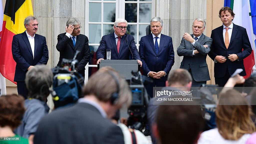 Luxembourg's Foreign minister Jean Asselborn, Italy's Foreign minister Paolo Gentiloni, Germany's Foreign minister Frank-Walter Steinmeier, Belgium's Foreign minister Didier Reynders, France's Foreign minister Jean-Marc Ayrault and Netherlands' Foreign minister Bert Koenders attend a press confeence after post-Brexit talks at the Villa Borsig in Berlin on June 25, 2016. The EU's founding states said they want Britain to begin leaving the union 'as soon as possible', as France urged a new British prime minister to take office quickly. / AFP / John MACDOUGALL