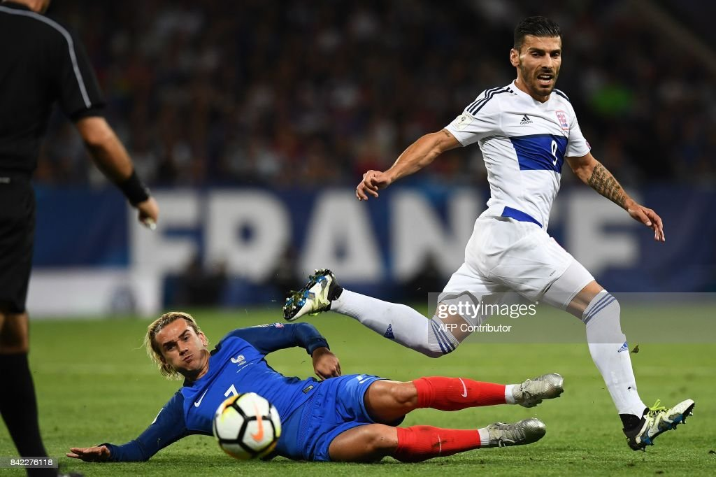 Luxembourg's forward Daniel Alves Da Motta (R) is tackled by France's forward Antoine Griezmann during the FIFA World Cup 2018 qualifying football match France vs Luxembourg at The Municipal Stadium in Toulouse, southern France on September 3, 2017. /