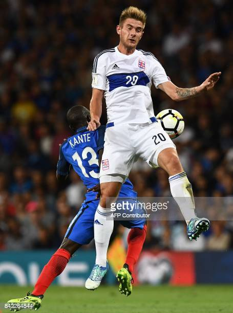 Luxembourg's forward David Turpel vies with France's midfielder N'Golo Kante during the FIFA World Cup 2018 qualifying football match France vs...