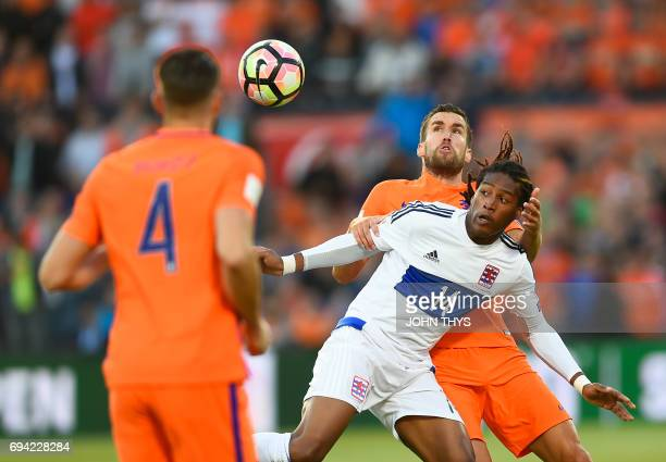 Luxembourg's Gerson Rodriguez vies with Dutch's Kevin Strootman during the FIFA World Cup 2018 qualification football match between Netherlands and...