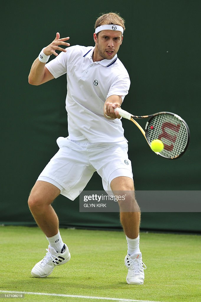 Luxembourg's Gilles Muller plays a forehand shot during his first round men's singles match against France's Julien Benneteau on the first day of the 2012 Wimbledon Championships tennis tournament at the All England Tennis Club in Wimbledon, southwest London, on June 25, 2012.