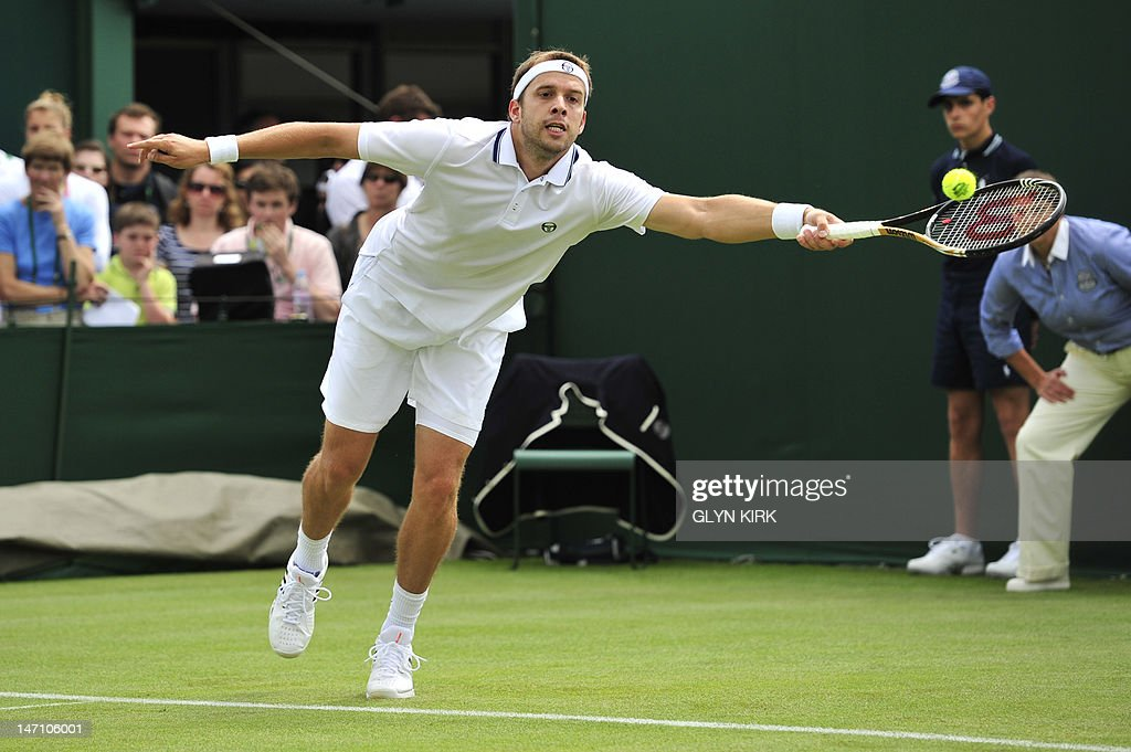 Luxembourg's Gilles Muller plays a shot during his first round men's singles match against France's Julien Benneteau on the first day of the 2012 Wimbledon Championships tennis tournament at the All England Tennis Club in Wimbledon, southwest London, on June 25, 2012.
