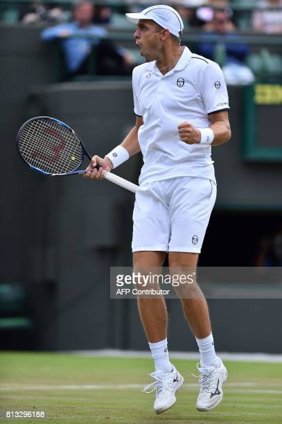 Luxembourg's Gilles Muller reacts after taking the score to 65 in the fourth set against Croatia's Marin Cilic during their men's singles...