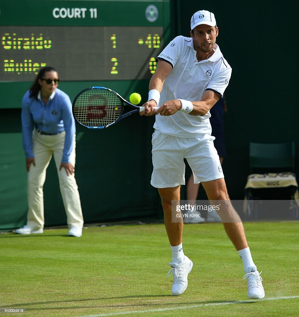 Luxembourg's Gilles Muller returns against Colombia's Santiago Giraldo during their men's singles first round match on the first day of the 2016 Wimbledon Championships at The All England Lawn Tennis Club in Wimbledon, southwest London, on June 27, 2016. / AFP / GLYN