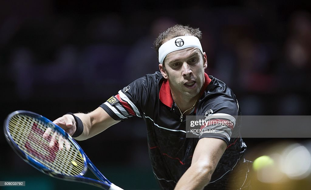 Luxembourg's Gilles Muller returns the ball to Italy's Andreas Seppi during their first round match as part of the ABN AMRO World Tennis Tournament in Rotterdam, on February 9, 2016. / AFP / ANP / Koen Suyk / Netherlands OUT