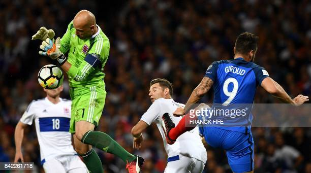 Luxembourg's goalkeaper Jonathan Joubert grabs the ball under pressure from France's forward Olivier Giroud during the FIFA World Cup 2018 qualifying...