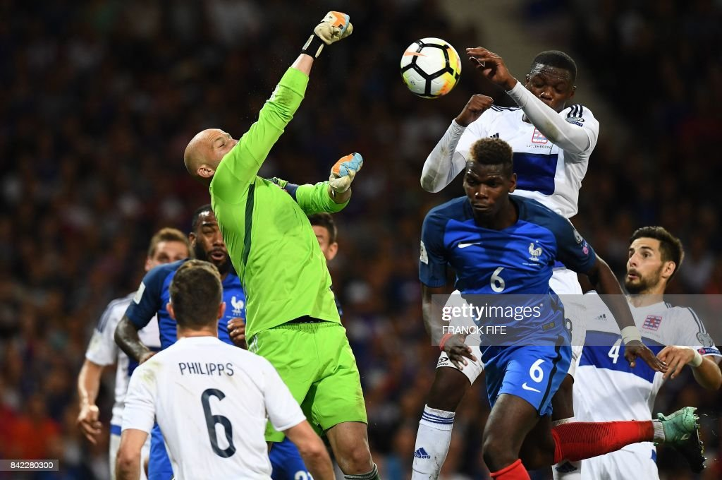 TOPSHOT - Luxembourg's goalkeaper Jonathan Joubert (L) jumps for the ball during the FIFA World Cup 2018 qualifying football match France vs Luxembourg at The Municipal Stadium in Toulouse, southern France, on September 3, 2017. /