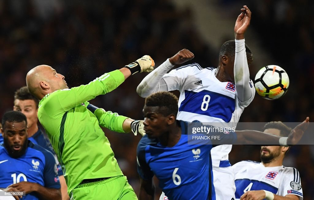Luxembourg's goalkeaper Jonathan Joubert (L) jumps for the ball during the FIFA World Cup 2018 qualifying football match France vs Luxembourg at The Municipal Stadium in Toulouse, southern France, on September 3, 2017. /
