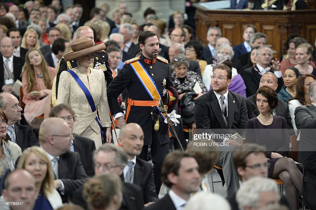 Luxembourg's Grand Duke Guillaume (R) and Grand Duchess Stephanie arrive to attend the inauguration of King Willem-Alexander of the Netherlands at Nieuwe Kerk (New Church) in Amsterdam on April 30, 2013.