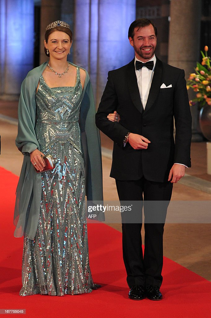 Luxembourg's Grand Duke Guillaume (R) and his wife Grand Duchess Stephanie pose on April 29, 2013 as they arrive to attend a dinner at the National Museum (Rijksmuseum) in Amsterdam hosted by Queen Beatrix of the Netherlands on the eve of her abdication.