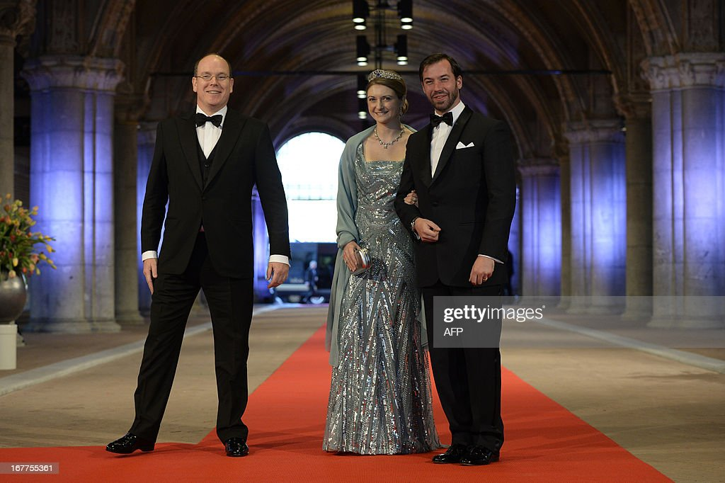 Luxembourg's Grand Duke Guillaume (R), his wife Grand Duchess Stephanie (R) and Prince Albert II of Monaco pose on April 29, 2013 as they arrive to attend a dinner at the National Museum (Rijksmuseum) in Amsterdam hosted by Queen Beatrix of the Netherlands on the eve of her abdication.