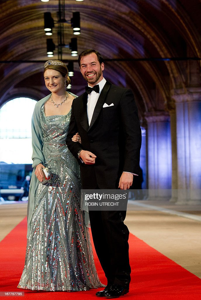 Luxembourg's Grand Duke Guillaume (R), his wife Grand Duchess Stephanie pose on April 29, 2013 as they arrive to attend a dinner at the National Museum (Rijksmuseum) in Amsterdam hosted by Queen Beatrix of the Netherlands on the eve of her abdication.