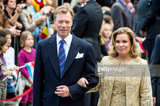 Luxembourg's Grand Duke Henri and Grand Duchess Maria Teresa arrive at the city hall to attend the civil wedding ceremony of Belgian Countess...