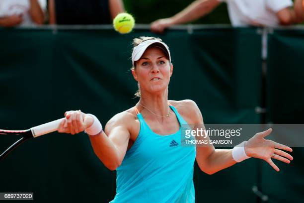 Luxembourg's Mandy Minella returns the ball to Belgium's Kirsten Flipkens during their tennis match at the Roland Garros 2017 French Open on May 29...