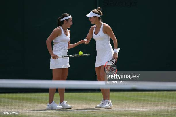 Luxembourg's Mandy Minella touches hands with her partner Latvia's Anastasija Sevastova after a point against Turkey's Ipek Soylu and Thailand's...