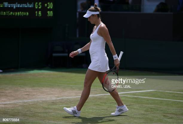 Luxembourg's Mandy Minella walks back to her mark after a point with her partner Latvia's Anastasija Sevastova against Turkey's Ipek Soylu and...