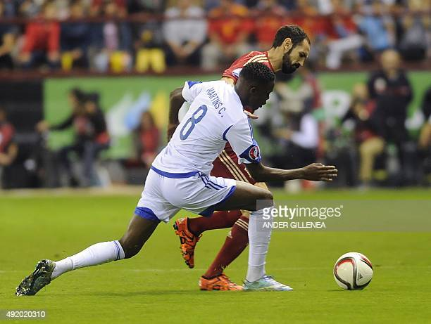 Luxembourg's midfielder Christopher Martins Pereira vies with Spain's defender Juanfran during the Euro 2016 qualifying football match Spain vs...