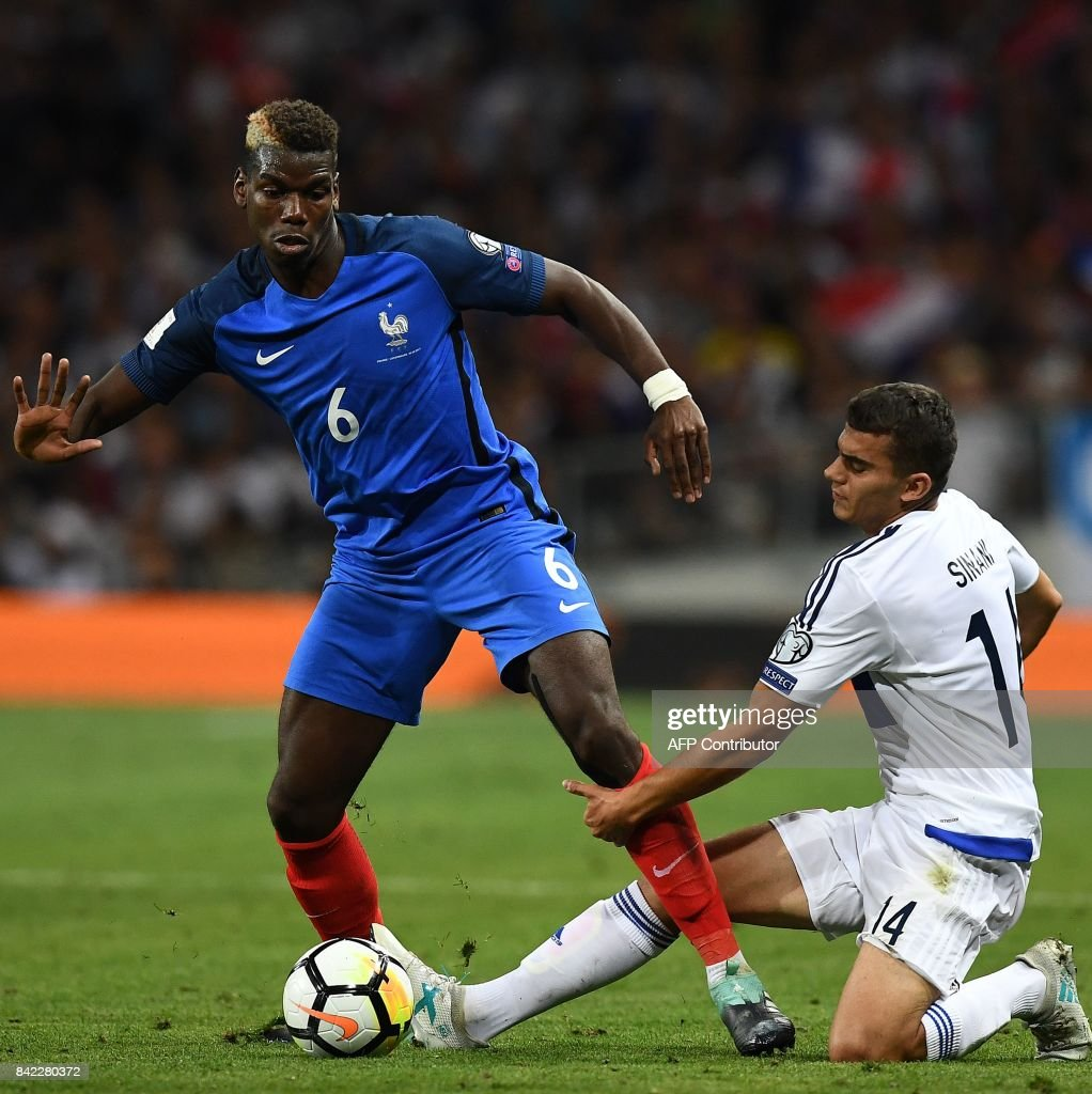Luxembourg's midfielder Danel Sinani (R) fights for the ball with France's midfielder Paul Pogba during the FIFA World Cup 2018 qualifying football match France vs Luxembourg at The Municipal Stadium in Toulouse, southern France, on September 3, 2017. /