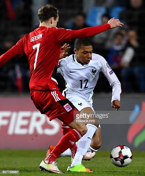 Luxembourg's midfielder Lars Gerson vies with France's forward Kylian Mbappe during the FIFA World Cup 2018 qualifying football match Luxembourg vs...
