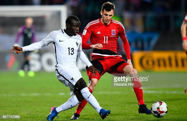Luxembourg's midfielder Stefano Bensi vies with France's midfielder N'Golo Kante during the FIFA World Cup 2018 qualifying football match between...