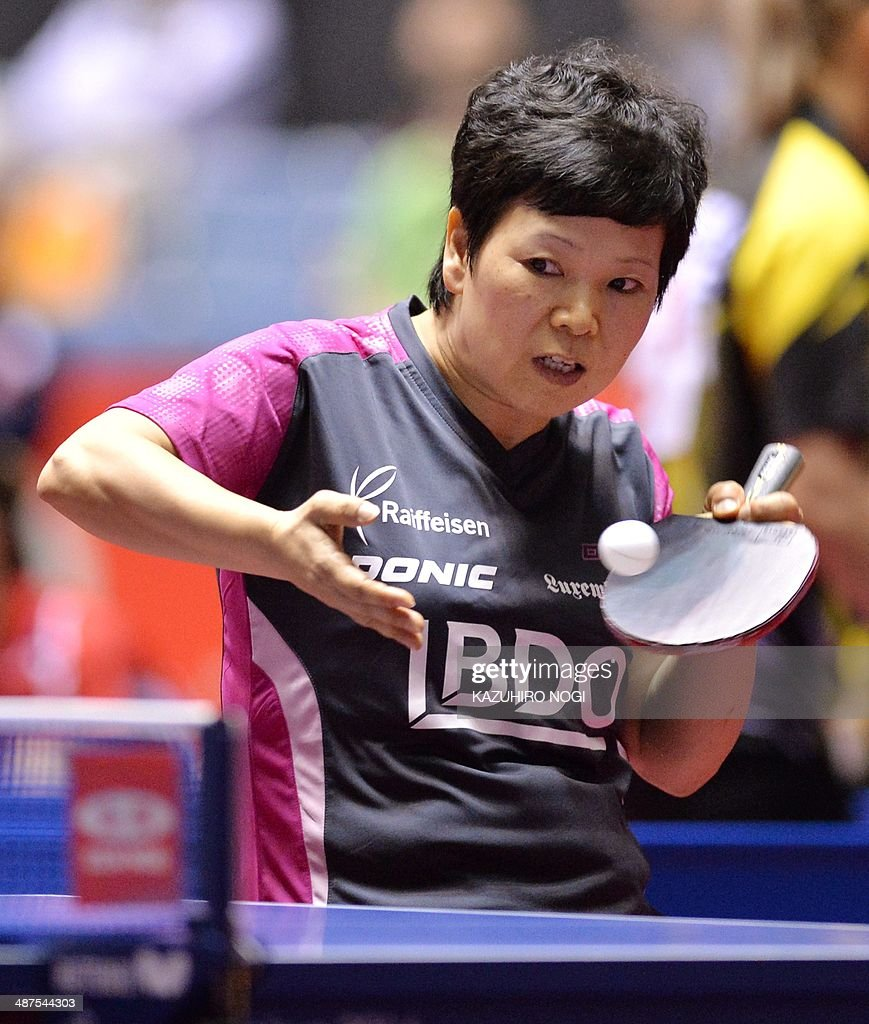 Luxembourg's Ni Xialian serves against South Korea's Seok Hajung during their match in the women's team championship division group C at the 2014 World Team Table Tennis Championships in Tokyo on May 1, 2014. AFP PHOTO / KAZUHIRO NOGI