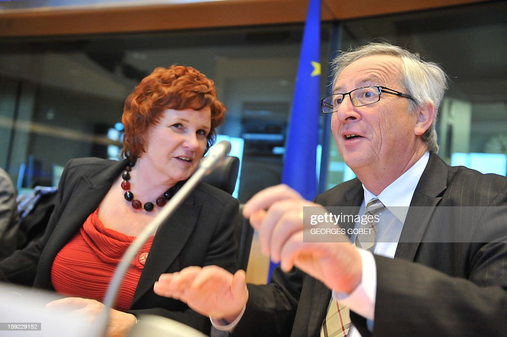 Luxembourg's Prime Minister and Eurogroup president Jean-Claude Juncker (R) and Chair of the European Parliament economics and monetary committee Sharon Bowles attend the commission meeting on 'Economic and Monetary Affairs' of the European Parliament on January 10,2013, at the EU headquarters in Brussels. Jean-Claude Juncker will present his analysis of the political, economic and financial conditions in the euro area and answer questions from members of the EP Commission.