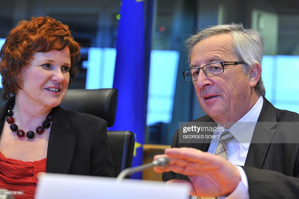 Luxembourg's Prime Minister and Eurogroup president Jean-Claude Juncker (R) and Chair of the European Parliament economics and monetary committee Sharon Bowles attend the commission meeting on 'Economic and Monetary Affairs' of the European Parliament on January 10,2013, at the EU headquarters in Brussels. Jean-Claude Juncker will present his analysis of the political, economic and financial conditions in the euro area and answer questions from members of the EP Commission. AFP PHOTO / GEORGES GOBET