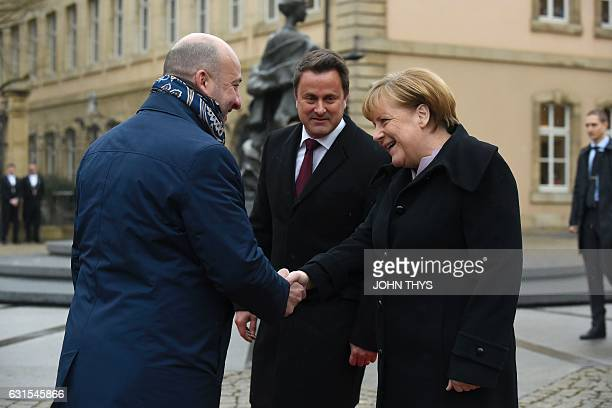 Luxembourg's Prime minister Xavier Bettel and Deputy Prime Minister Etienne Schneider welcome German Chancellor Angela Merkel during a visit in...