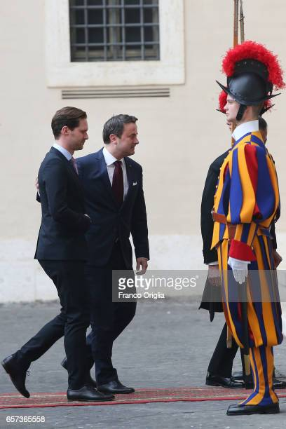 Luxembourg's Prime Minister Xavier Bettel and partner Gauthier Destenay arrive at the Apostolic Palace for an audience of Pope Francis with 27 heads...