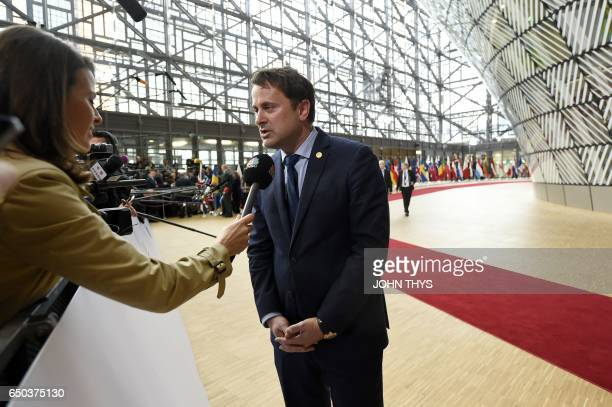 Luxembourg's Prime minister Xavier Bettel answers the press as he arrives to attend the EU summit at the new 'Europa' building in Brussels on March 9...