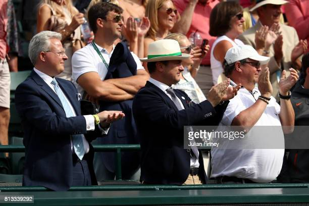 Luxembourg's Prime Minister Xavier Bettel applauds the Gentlemen's Singles quarter final match between Gilles Muller of Luxembourg and Marin Cilic of...