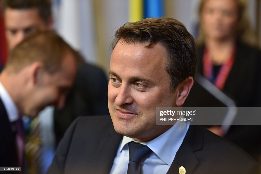 Luxembourg's Prime minister Xavier Bettel arrives for the second day of an EU - Summit at the EU headquarters in Brussels on June 29, 2016. European Union leaders will on June 29, 2016 assess the damage from Britain's decision to leave the bloc and try to prevent further disintegration, as they meet for the first time without a British representative. / AFP / PHILIPPE