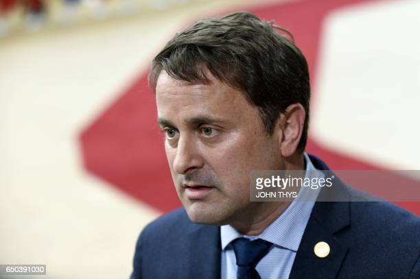 Luxembourg's Prime minister Xavier Bettel arrives to take part in the EU summit at the new 'Europa' building in Brussels on March 9 2017 / AFP PHOTO...
