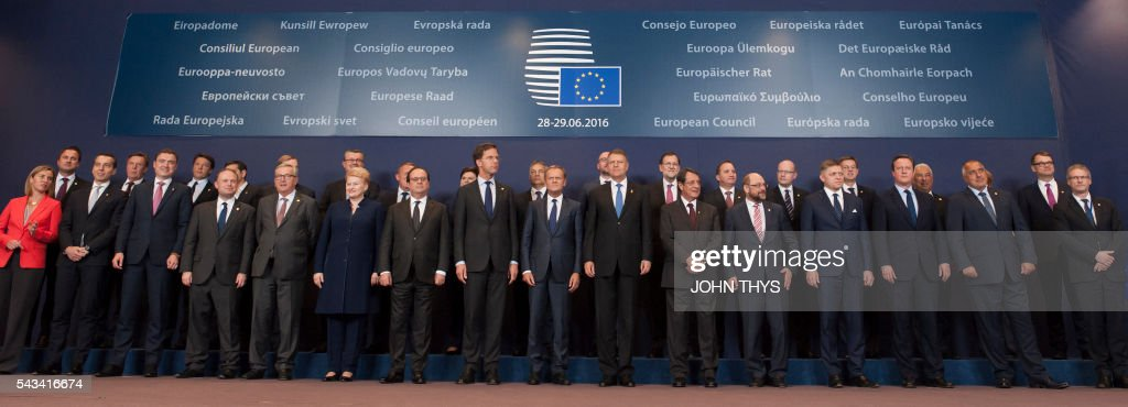 Luxembourg's Prime minister Xavier Bettel, Latvia's Prime minister Maris Kucinskis, Italy's Prime minister Matteo Renzi, Greece's Prime minister Alexis Tsipras, Ireland's Prime minister Enda Kenny, Croatia's Prime minister Tihomir Oreekovic, Denmark's Prime minister Lars Lokke Rasmussen, Poland's Prime minister Beata Szyd?o, Hungary's Prime minister Viktor Orban, Belgium's Prime minister Charles Michel, Spain's Prime minister Mariano Rajoy, Sweden's Prime minister Stefan Lofven, Czech Republic's Prime minister Bohuslav Sobotka, Slovenia's Prime minister Miro Cerar, Portugal's Prime minister Antonio Costa, Germany's Chancellor Angela Merkel, Finland's Prime minister Juha Sipila, EU's High representative for foreign affairs and security policy Federica Mogherini, Austrian chancellor Christian Kern, Estonia's Prime minister Taavi Roivas, Malta's Prime minister Joseph Musca, European Commission President Jean-Claude Juncker, Lithuania's President Dalia Grybauskaite, France's President Francois Hollande, Netherland's Prime minister Mark Rutte, European Council President Donald Tusk, Romania's President Klaus Werner Iohannis, Cyprus' President Nicos Anastasiades, European Parliament President Martin Schulz, Slovakia's Prime minister Robert Fico, Britain's Prime minister David Cameron, Bulgaria's Prime minister Boyko Borissov pose for a family photo during the European Summit at the EU headquarters in Brussels on June 28, 2016. / AFP / JOHN