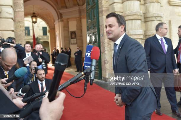 Luxembourg's Prime Minister Xavier Bettel speaks to the press as he arrives for an European Union summit on February 3 2017 in Valletta Malta...