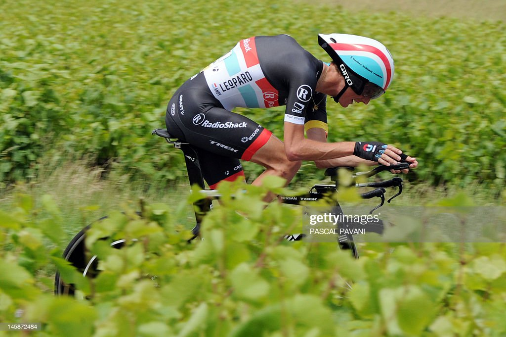 Luxemburg's Andy Schleck competes on June 7, 2012, during the 53,5 km time-trial of the 64th edition of the Dauphine Criterium cycling race run, between Villie-Morgon and Bourg-en-Bresse, southeastern France.
