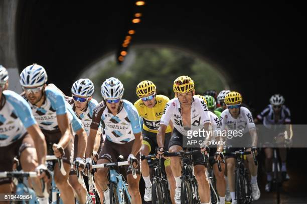 Luxemburg's Ben Gastauer France's Romain Bardet France's Alexis Vuillermoz Great Britain's Christopher Froome wearing the overall leader's yellow...