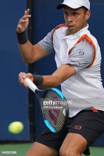 Luxemburg's Gilles Muller returns the ball to Australia's Bernard Tomic during their Men's Singles match at the 2017 US Open Tennis Tournament on...