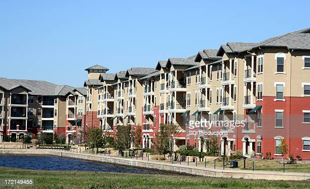 Luxurious Apartment Complex Overlooking A Pond