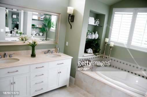 luxurious bathroom in green and white
