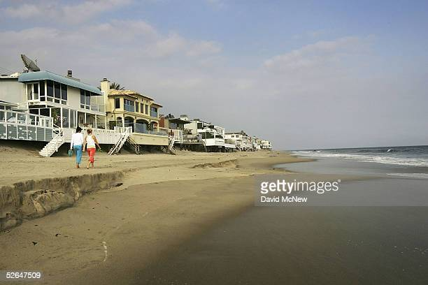 Luxurious beach houses crowd the shoreline hiding Carbon Beach a public beach that was gotten to through a recently opened public accessway next to...